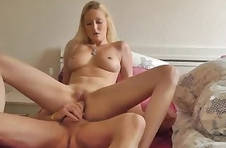 Fit blonde with good hooters in dick riding